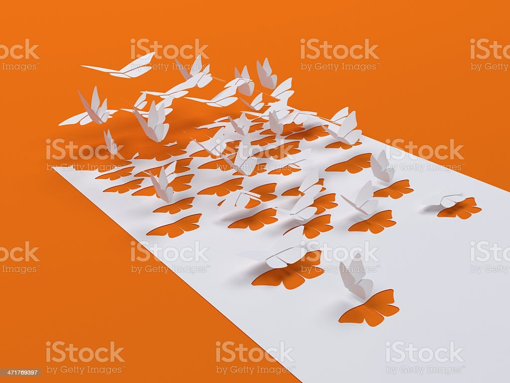 Butterfly flying out of a white paper royalty-free stock photo