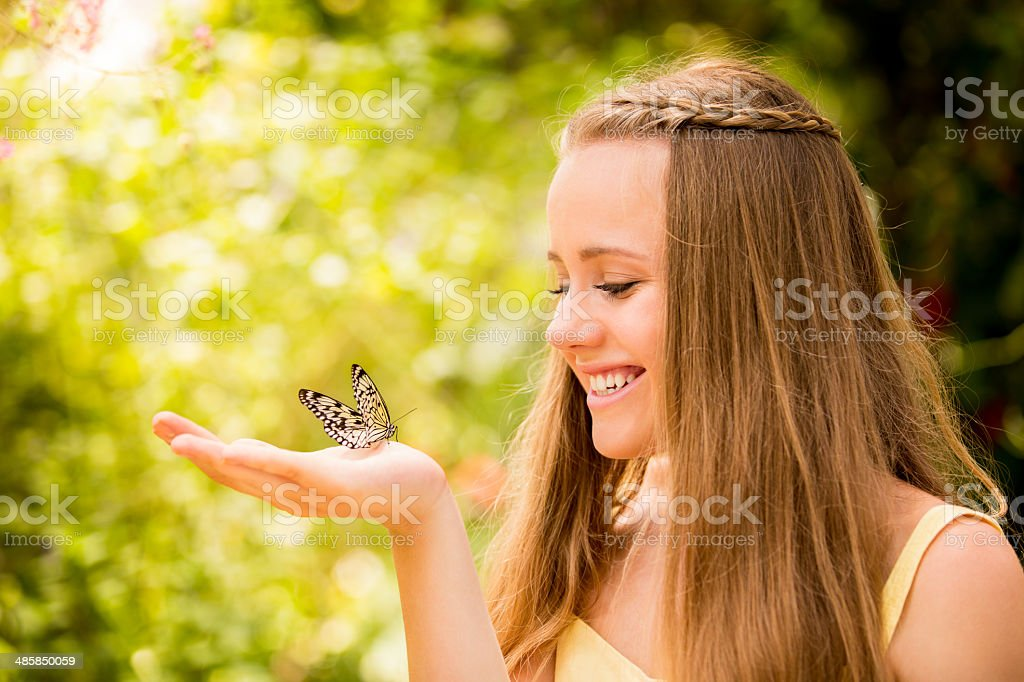 Butterfly on girls hand stock photo