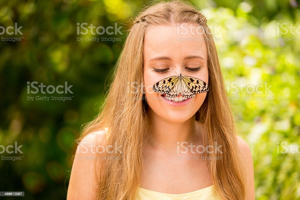 Butterfly on girls nose stock photo