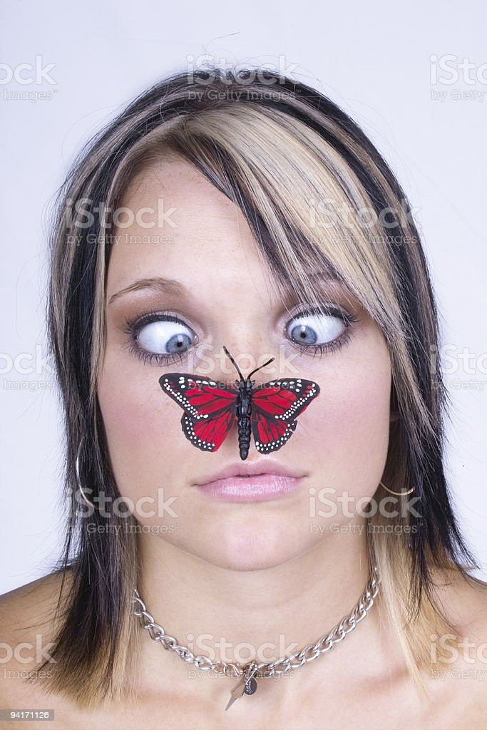 Butterfly on Girl's Nose royalty-free stock photo