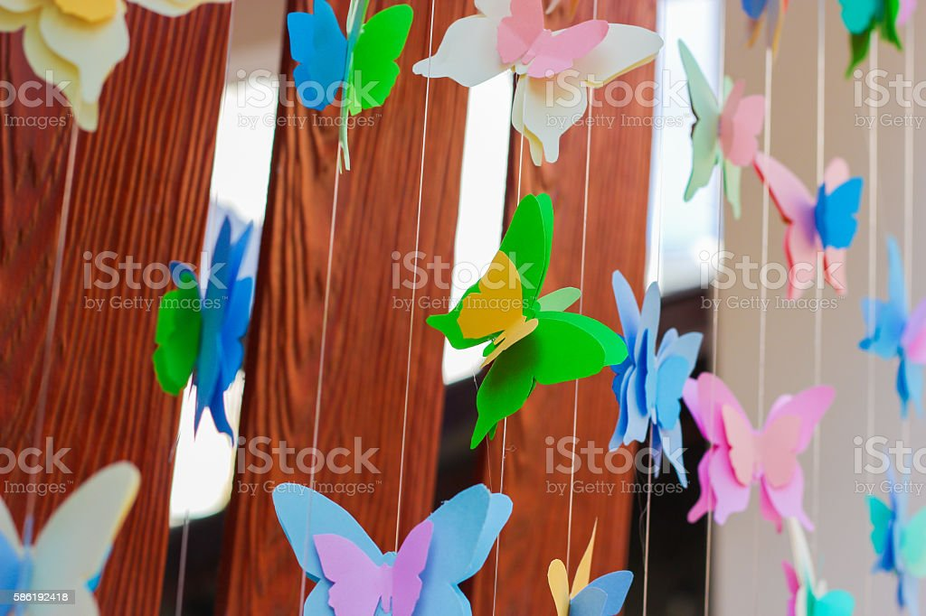 butterfly paper on yarn line stock photo