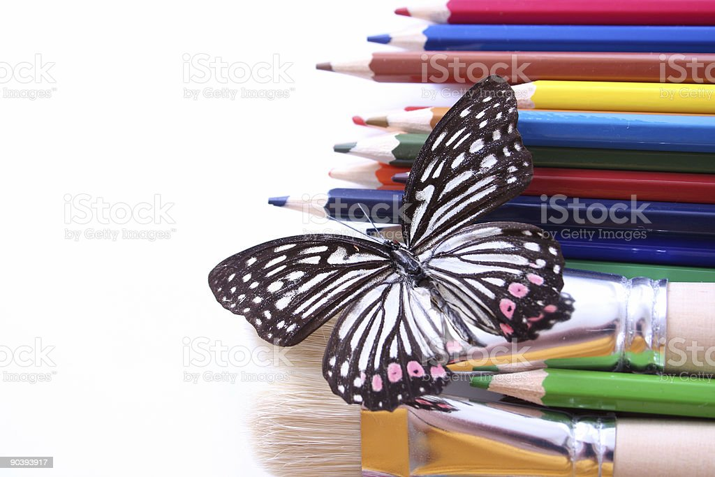 Butterfly sitting on artist tools royalty-free stock photo