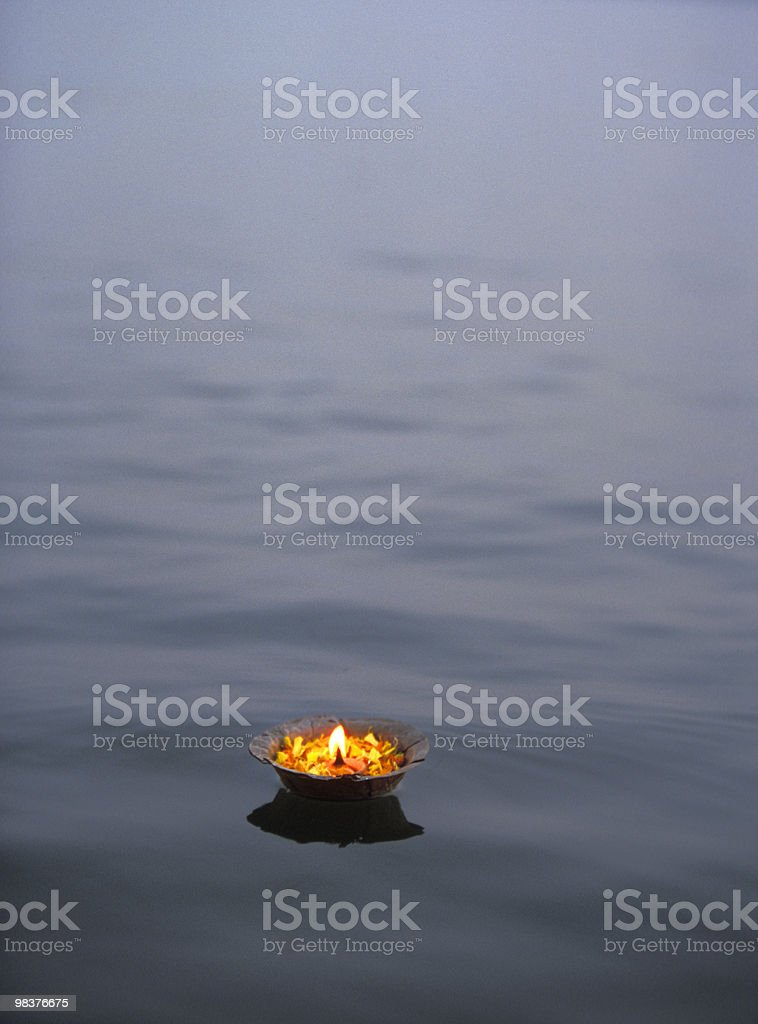 Butterlamp on Ganges stock photo