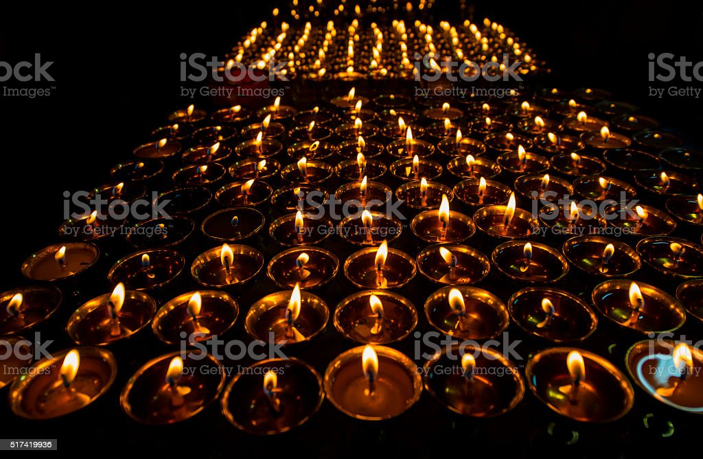 Butterlamps or Candles in a buddhist monastery, Tibet stock photo