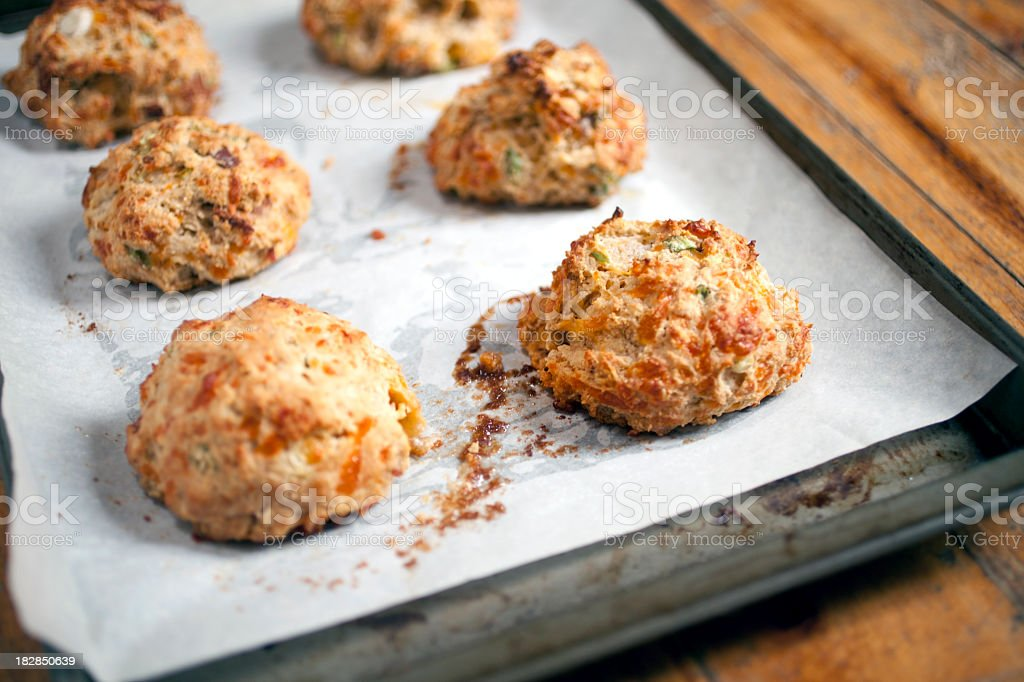 Buttermilk biscuits with cheddar on a baking pan royalty-free stock photo