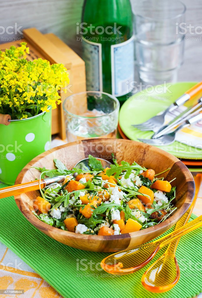 Butternut squash, arugula, couscous and feta salad stock photo