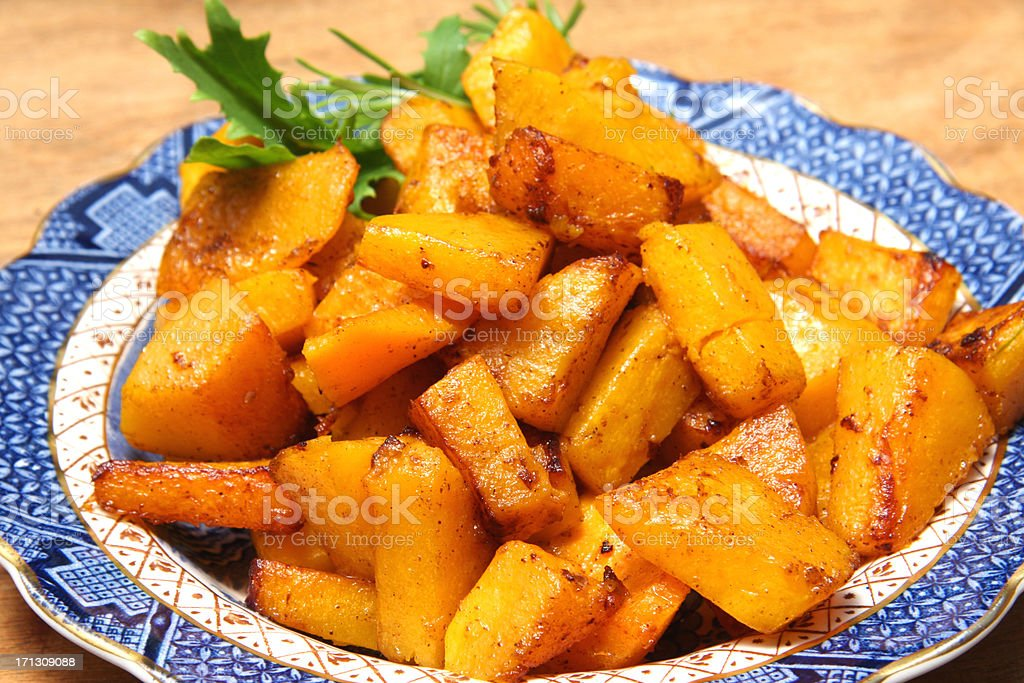Butternut squash fried with cinnamon stock photo