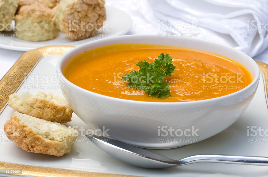 Butternut squash soup in a white bowl stock photo