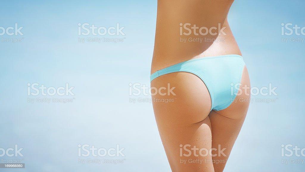 Buttocks in a bikini royalty-free stock photo