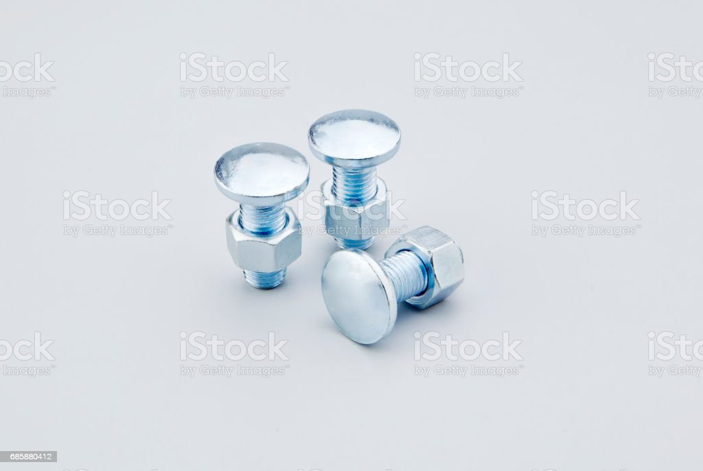 button head bolts, nuts and washers stock photo