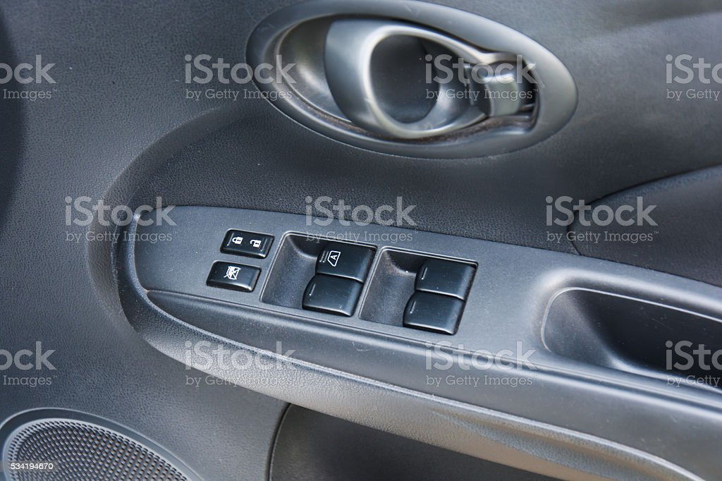 Button in car for adjust windows and lock the door. stock photo