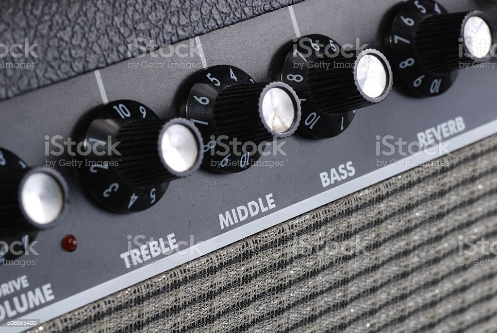 button of guitar amplifier stock photo