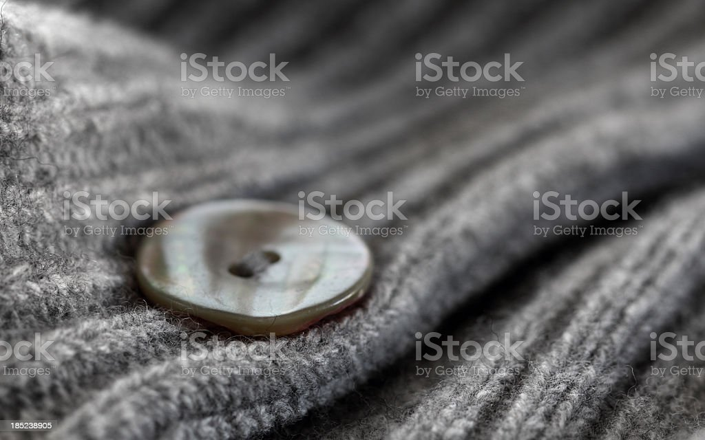 Button on a wool sweater royalty-free stock photo