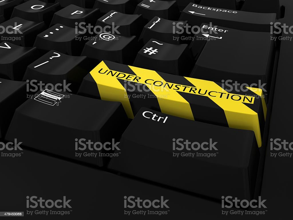 UNDER CONSTRUCTION Button on Black Keyboard stock photo