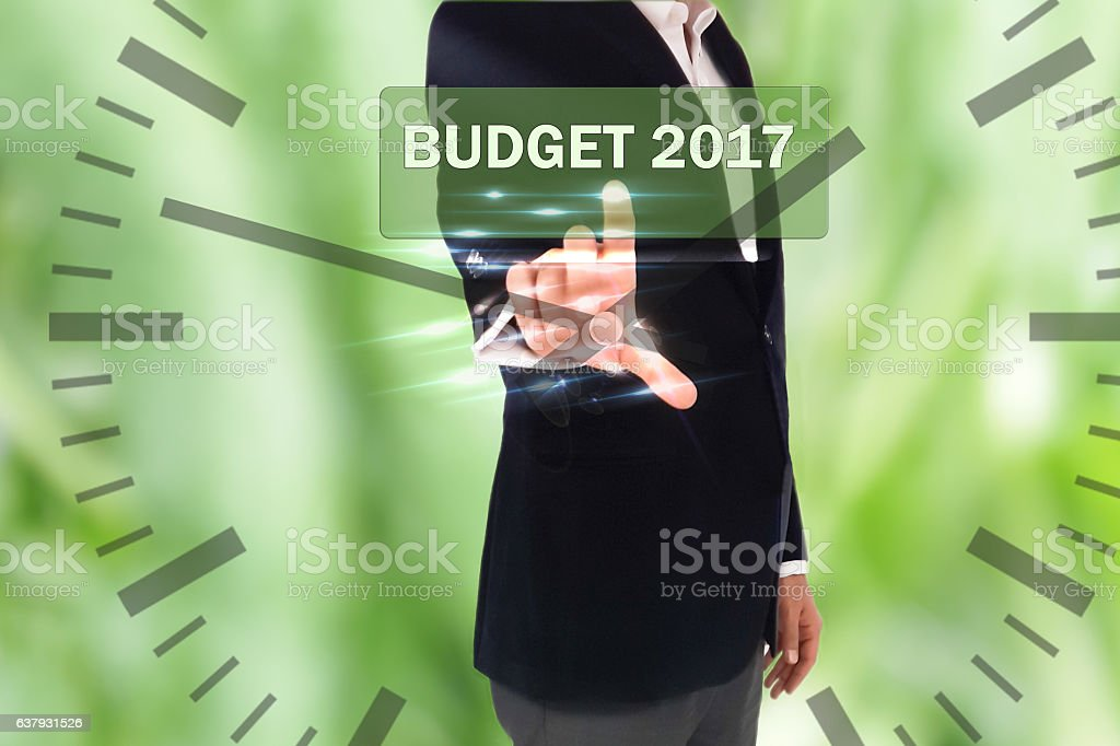 button on touch screen interface and selecting budget 2017 stock photo