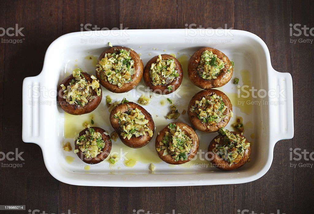Button, portobello mushrooms stuffed with cheese and herbs stock photo