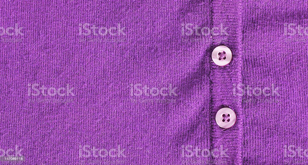 Buttoned up purple cotton cloth stock photo