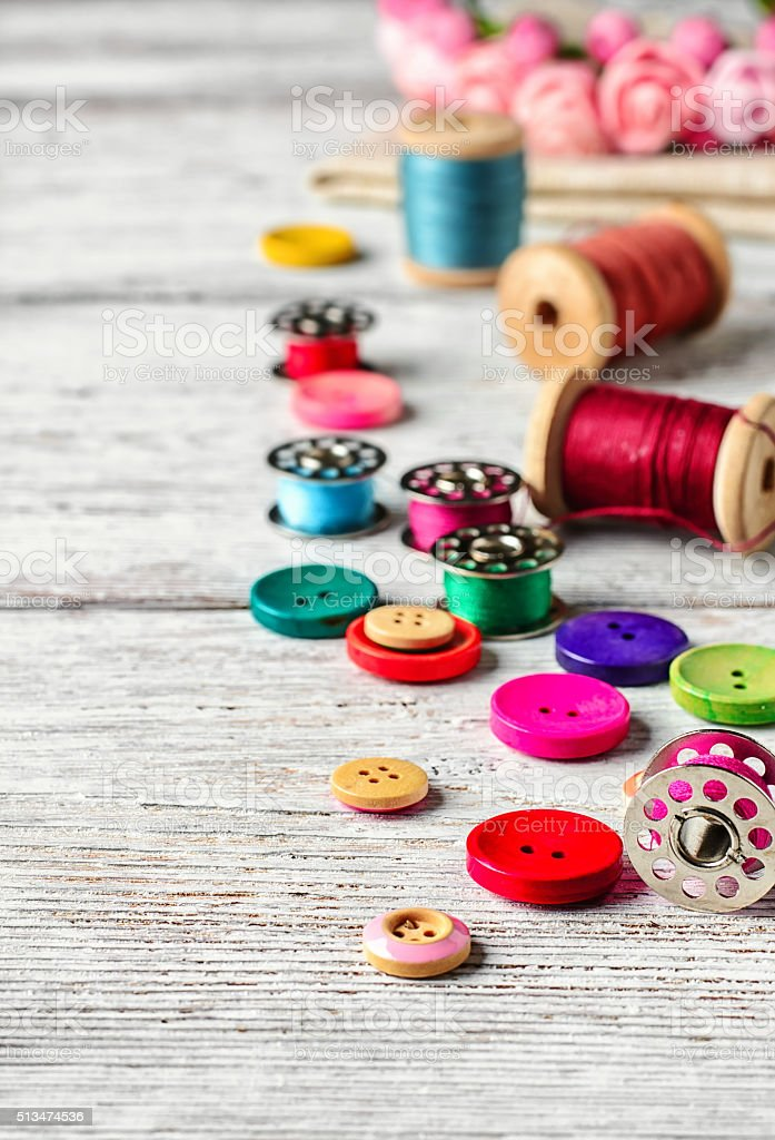 Buttons and spool of thread stock photo