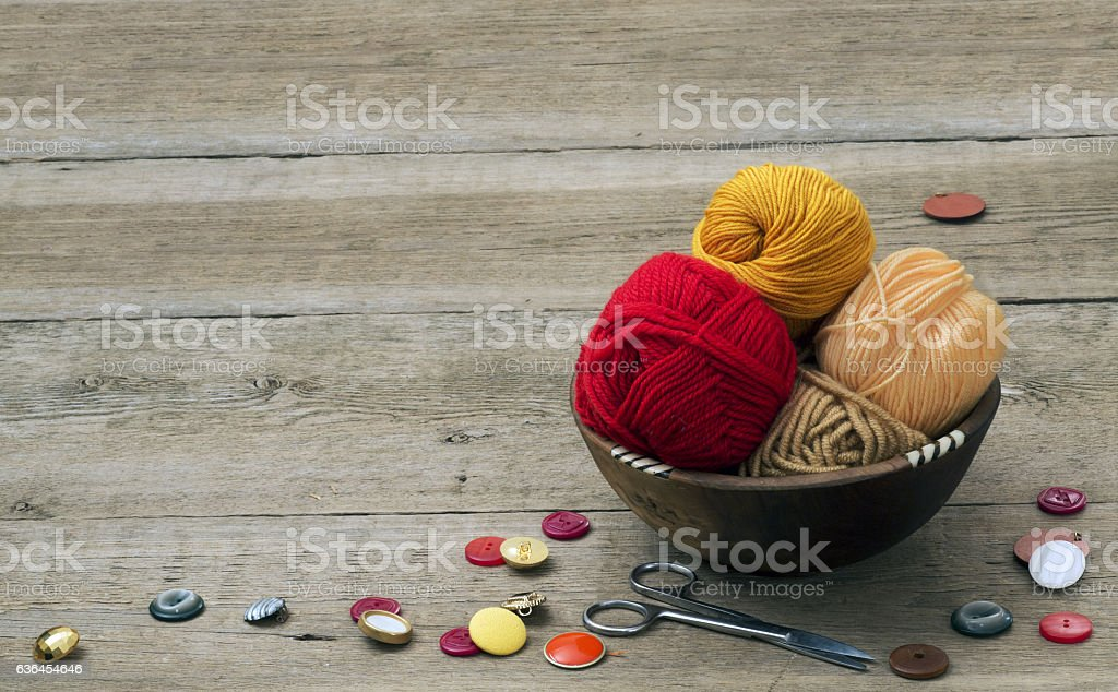 buttons, scissors and yarn stock photo