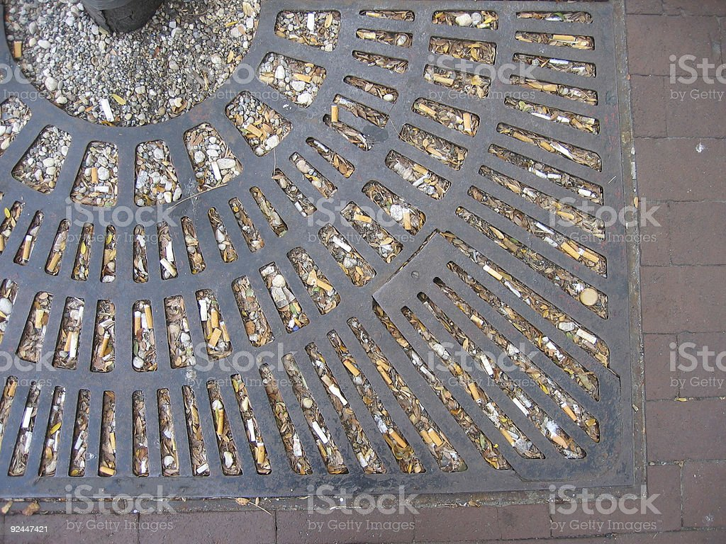 Butts in a Grate stock photo