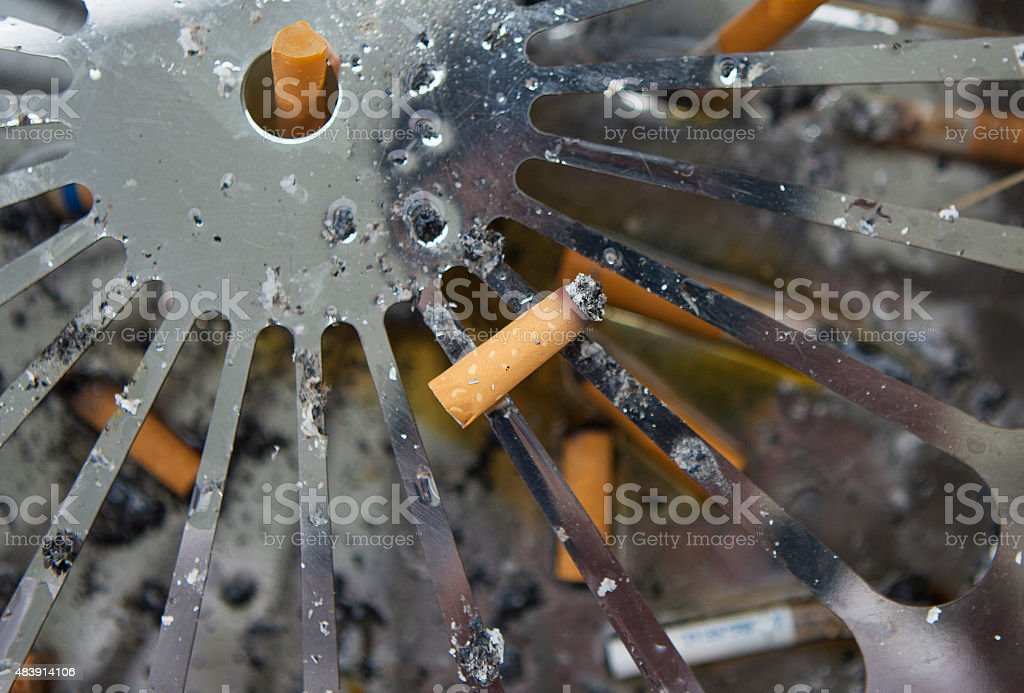 Butts of cigarette, used filter less on a astray stock photo