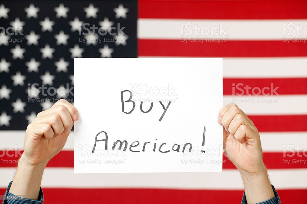 Buy American Sign and Flag royalty-free stock photo