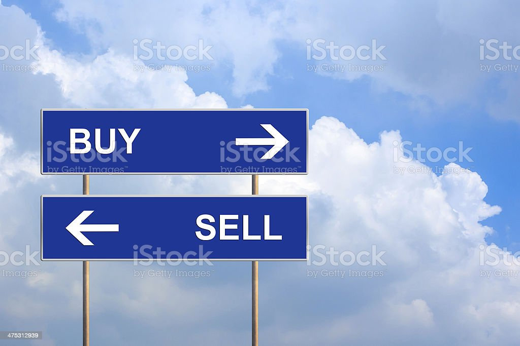 buy and sell on blue road sign stock photo