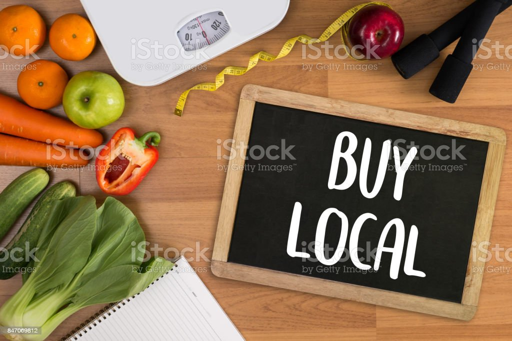 Buy Local Fresh produce on sale at the local farmers market stock photo