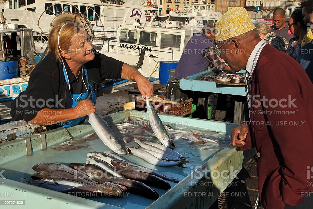 Buyer at the fish market in Marseille.  FRANCE stock photo