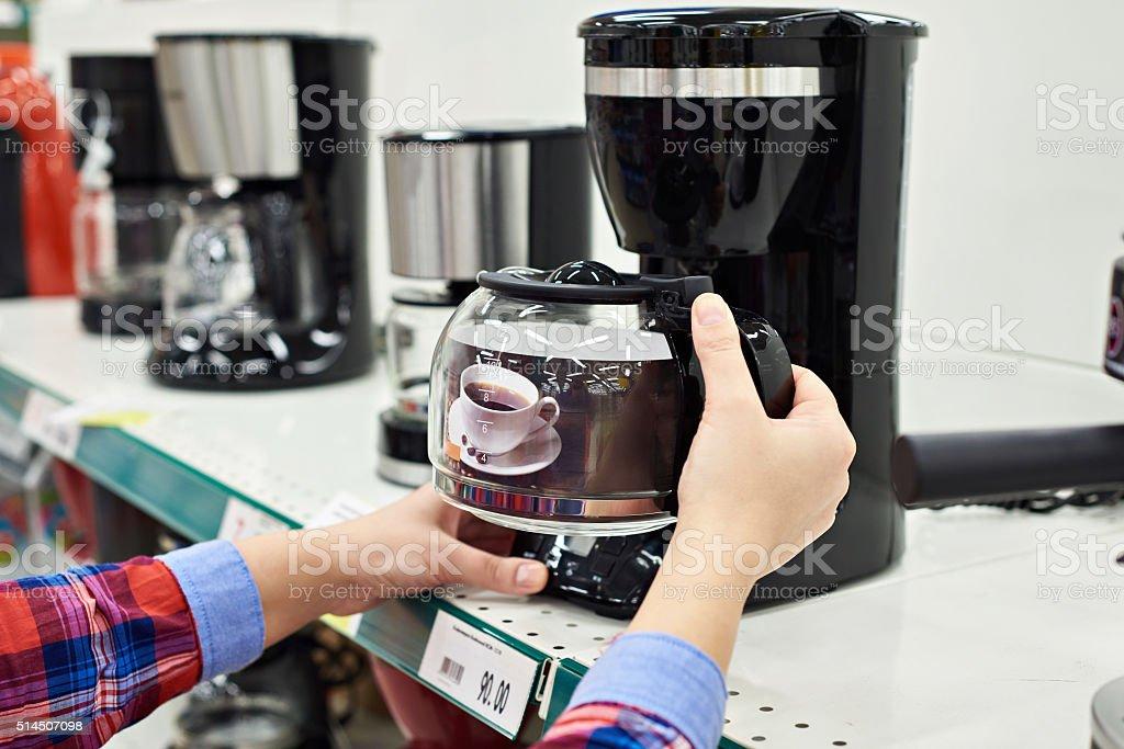 Buyer chooses coffee machine in store stock photo