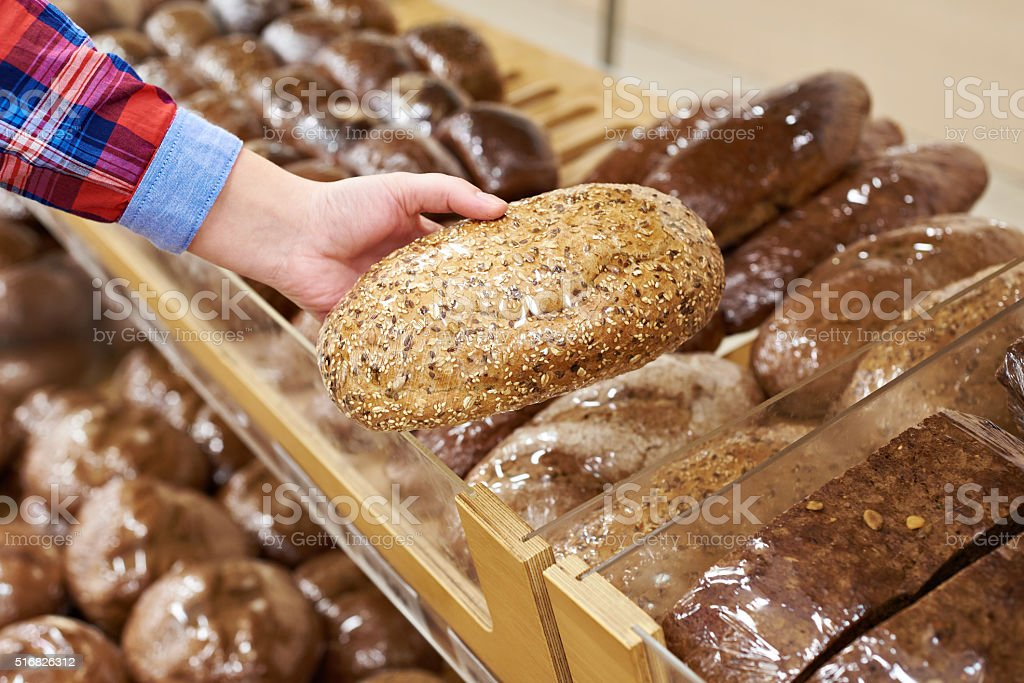 Buyer with bread in shop stock photo