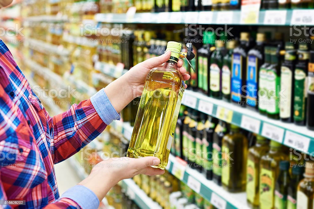 Buyer with sunflower oil in store stock photo