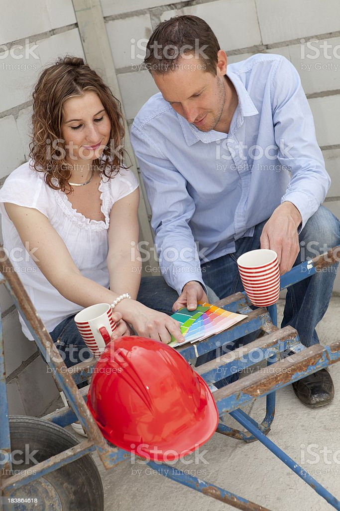 Buyers checking the new plans. royalty-free stock photo