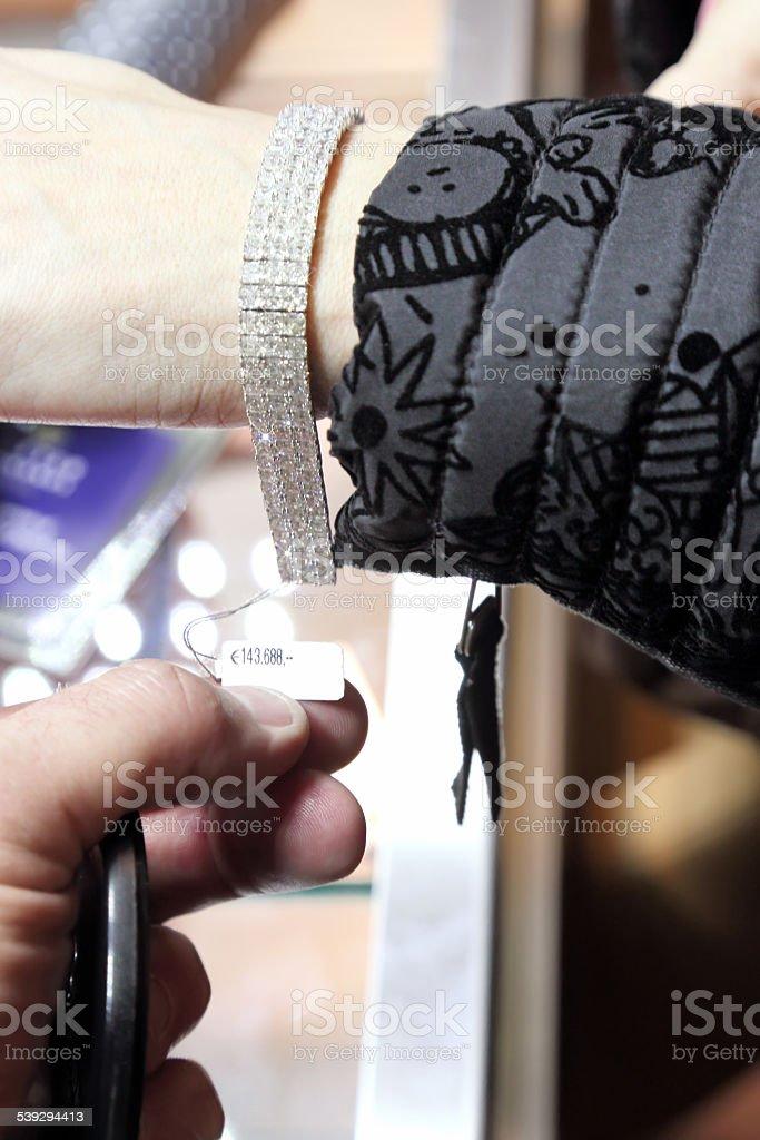 Buying a diamond bracelet stock photo