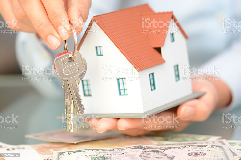 Buying a house concept with  model house and keys stock photo