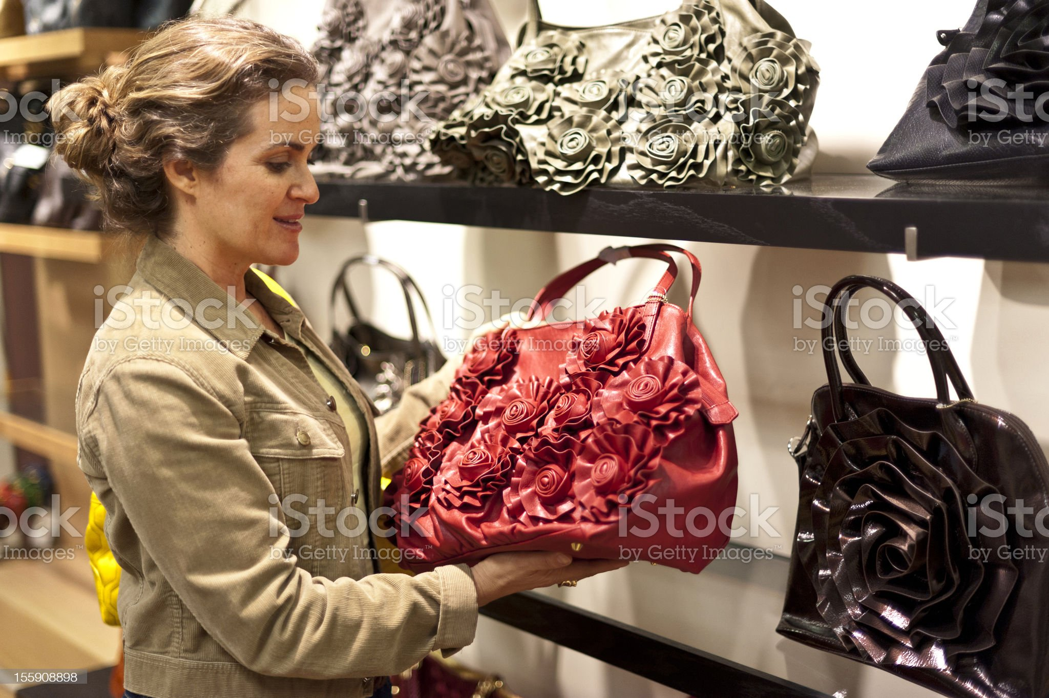 Buying a leather bag royalty-free stock photo