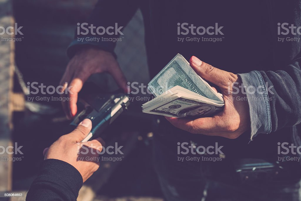 Buying a weapon stock photo