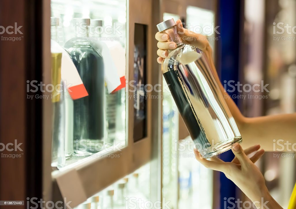 Buying alcohol stock photo