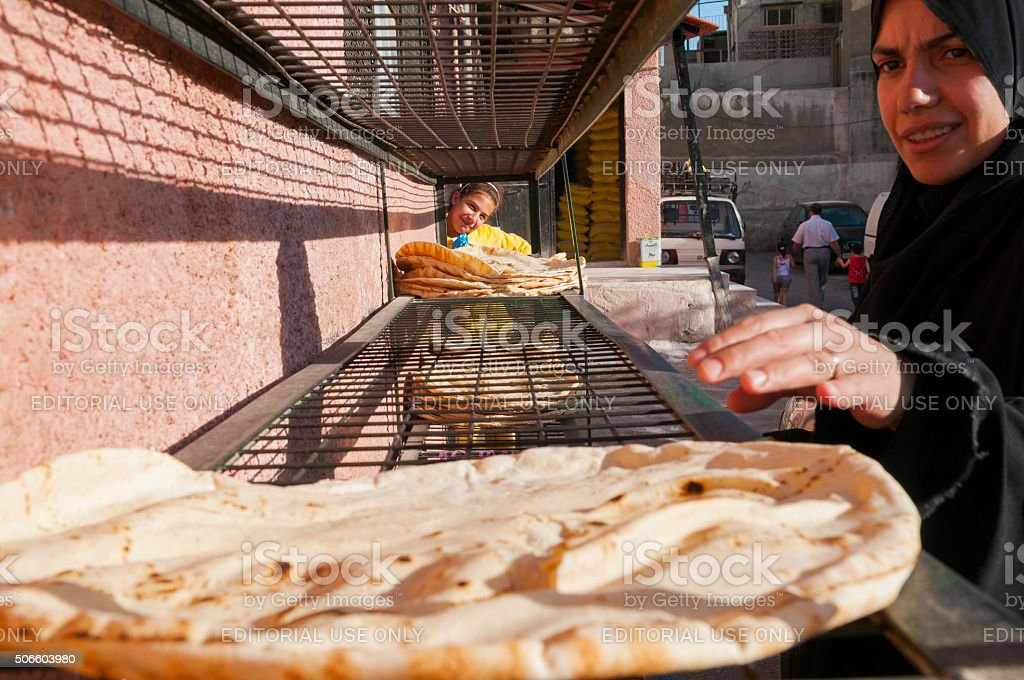 Buying bread in Damascus, Syria stock photo