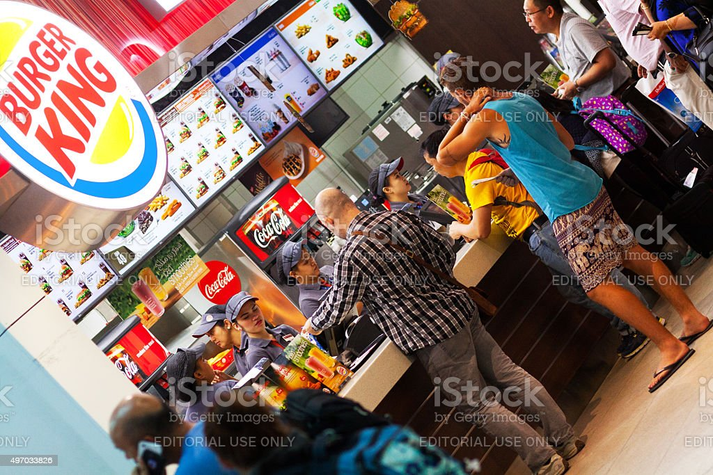 Buying burger and fast food in airport stock photo