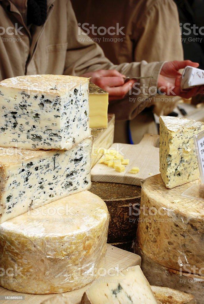 Buying cheese stock photo