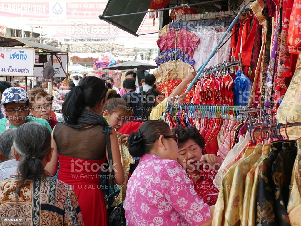 Buying Cheongsam of traditional Chinese clothes stock photo