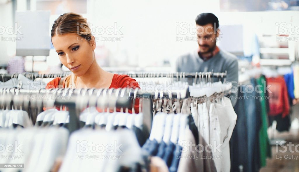 Buying clothes at a mall. stock photo