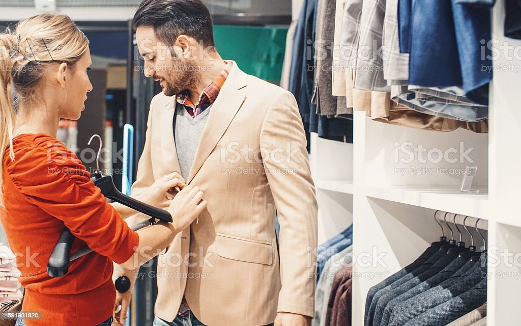 Buying clothes together. stock photo