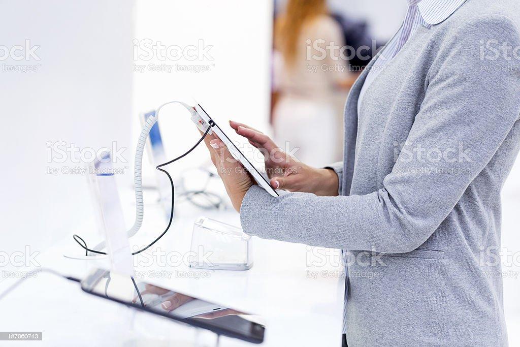 Buying digital tablet royalty-free stock photo