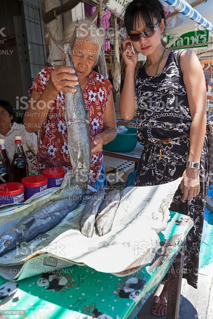 Buying dried fish. royalty-free stock photo