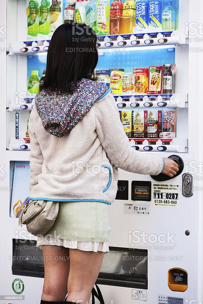 Buying Drink from Vending Machine Tokyo Japan stock photo
