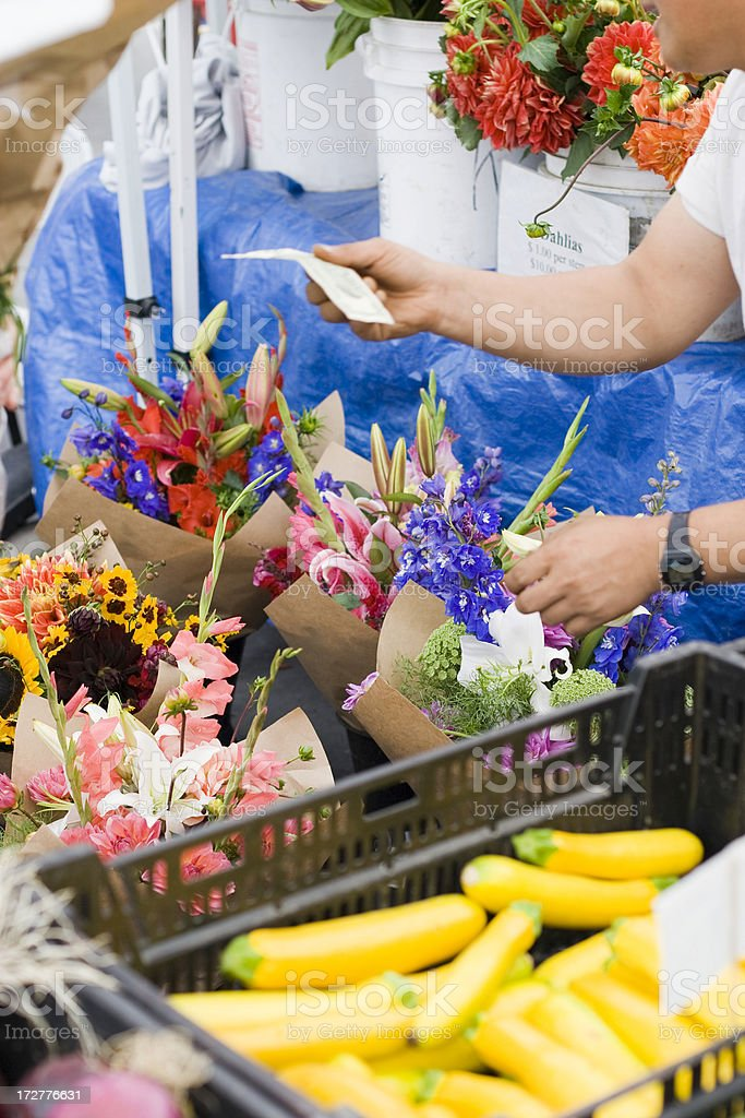 Buying flowers at farmers market stock photo