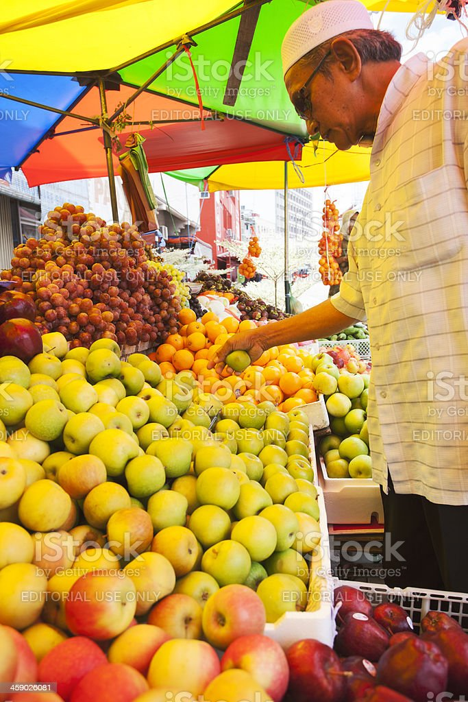 Buying for fast-breaking meal on a street stall. stock photo