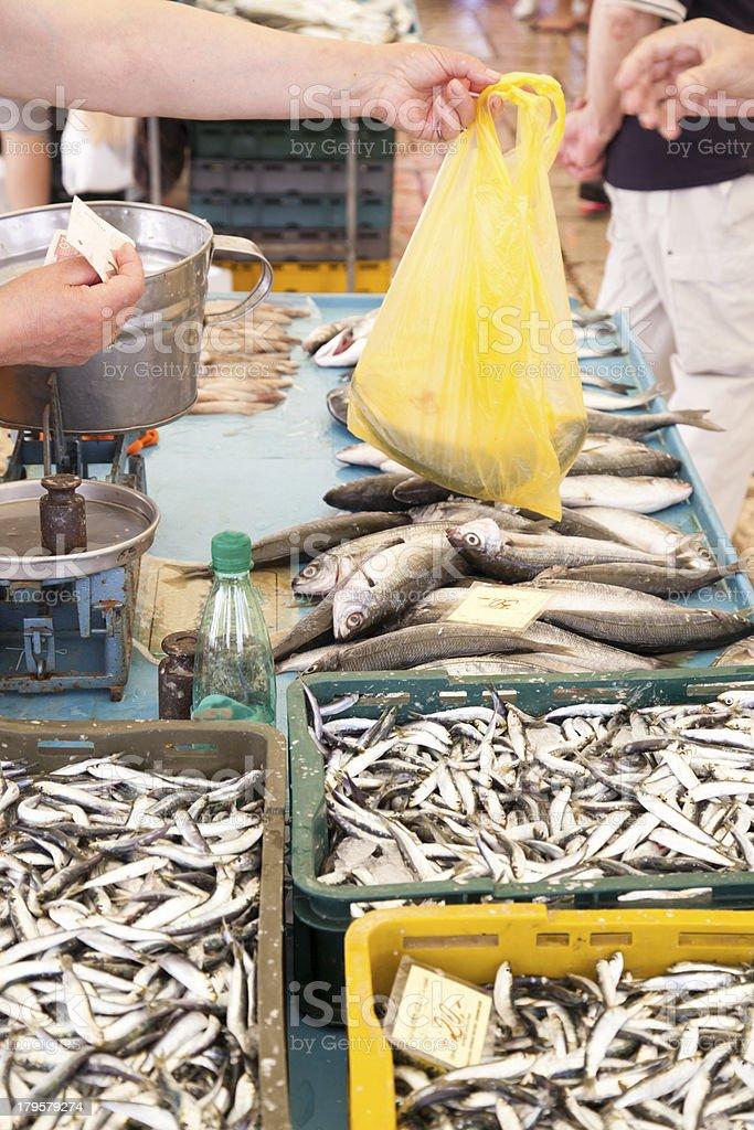 Buying fresh fish on market royalty-free stock photo